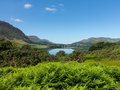 Reflection on lake district hills in crummock mirror like of the surrounding water framed by the trees the lakeside idyllic image Stock Images