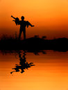 Reflection of man and woman love silhouette in sunset Stock Photo