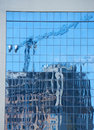 Reflection of the modern apartment building under construction Royalty Free Stock Photo