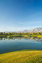 Reflection of mountains and palm trees golf course at pga west la quinta california Stock Image