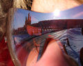 Reflection of nadym the girl in glasses the girl s face with gl Stock Images