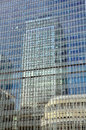 Reflection of office block in a financial centre london reflected in docklands area Royalty Free Stock Image
