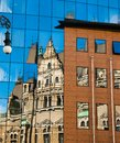 Reflection of an old building in new glass building. Old architecture versus modern reflected in glass. City of Liberec Royalty Free Stock Photo