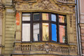 Reflection of old building in window in lodz on piotrkowska street poland Stock Photography