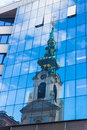Reflection of old church in modern building Royalty Free Stock Photo