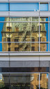 Reflection of Old High-Rise Brick Building in New Modern High-Ri Royalty Free Stock Photo