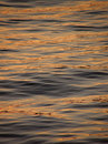 Reflection, ripple on gold sea Stock Photo