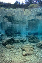 Reflection of rocks underwater in lake. Royalty Free Stock Photos