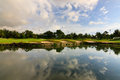 Reflection of sky at a golf course lake sabah malaysia Stock Photo