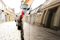 Reflection of street in car old with cobble stones side Stock Images