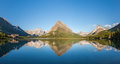 Reflection at Swiftcurrent lake - Glacier national Stock Photo
