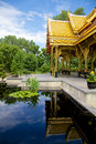 Reflection of a thai pavilion sala beautiful or in madison wisconsin sent as gift from thailand reflected in pool Stock Photo