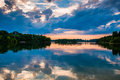 Reflection of trees and clouds at sunset in lake marburg codoru codorus state park pennsylvania Stock Photos