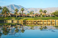 Reflection of trees and mountains at golf course pga west la quinta california this par hole requires crossing the pond in order Stock Photo