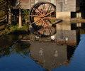 Reflection in the water of an old Grist Mill Royalty Free Stock Photo