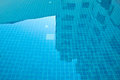 Reflections building in swimming pool blue Stock Photos