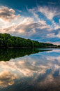 Reflections of clouds and trees at sunset in lake marburg codor codorus state park pennsylvania Royalty Free Stock Photography