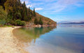 Reflections on corfu a beach under autumn clouds with the hills of albania in the distance Royalty Free Stock Photography