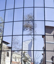 Reflections of houses and trees in a new glass building Royalty Free Stock Photo