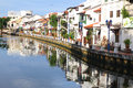 Reflections on melaka river crystal clear of buildings along Royalty Free Stock Photography