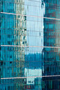Reflections in modern glass-walled building facade Royalty Free Stock Photo