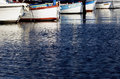 Reflections of old fishing boats port staint raphael the riviera france Stock Image