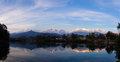 Reflections in phewa tal of the annapurna range lake pokhara at sunset nepal Stock Image