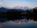 Reflections in phewa tal of the annapurna range lake pokhara at sunset nepal Royalty Free Stock Photo