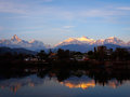 Reflections in phewa tal of the annapurna range lake pokhara at sunset nepal Royalty Free Stock Image