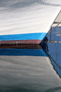 Reflections of the prow of an old sailboat colorful portrait cut Royalty Free Stock Photo