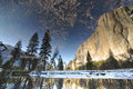 Reflections at yosemite in a river in national park Stock Image