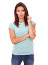 Reflective attractive woman looking at you portrait of years on blue t shirt while standing on isolated studio Royalty Free Stock Photos
