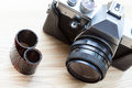 Reflex analogue camera a stylish and a roll of film Royalty Free Stock Image