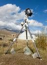 A reflex camera mounted on a tripod. Stock Image