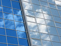Reflexion of the sky and clouds in windows Stock Image