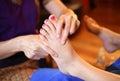 Reflexology foot massage, spa foot treatment by wood stick Royalty Free Stock Photo