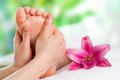 Reflexology massage close up of hands massaging female foot Royalty Free Stock Photography