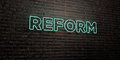 REFORM -Realistic Neon Sign on Brick Wall background - 3D rendered royalty free stock image