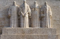 Reformation wall in geneva statues on switzerland from left to right william farel john calvin theodore de beze and john knox Royalty Free Stock Image