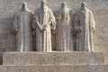 Reformation wall in geneva statues on switzerland from left to right william farel john calvin theodore de beze and john knox Stock Image
