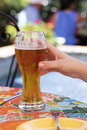 Refreshing beer and a local restaurant ordered before dinner at Royalty Free Stock Photos