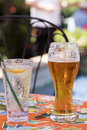 Refreshing beer and a local restaurant ordered before dinner at Royalty Free Stock Image
