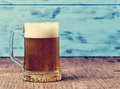 Refreshing beer served in a glass mug Royalty Free Stock Photo