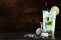 Refreshing christmas cocktail with a blend of white spirits mixer and fresh aromatic herbs in a tall glass with ice garnished with Royalty Free Stock Photo