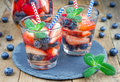 Refreshing cocktail with strawberry and blueberry Royalty Free Stock Photo