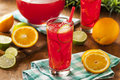 Refreshing cold fruit punch with berries and oranges Stock Images