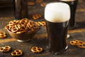 Refreshing dark stout beer ready to drink Stock Images