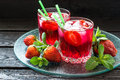Refreshing drink with strawberries and ice Royalty Free Stock Photo