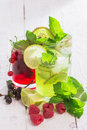 Refreshing drinks and various fresh fruits and berries on a wooden table Royalty Free Stock Photos