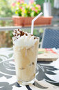 Refreshing frappe frappuccino with whipped cream and chocolate syrup and a straw Royalty Free Stock Image